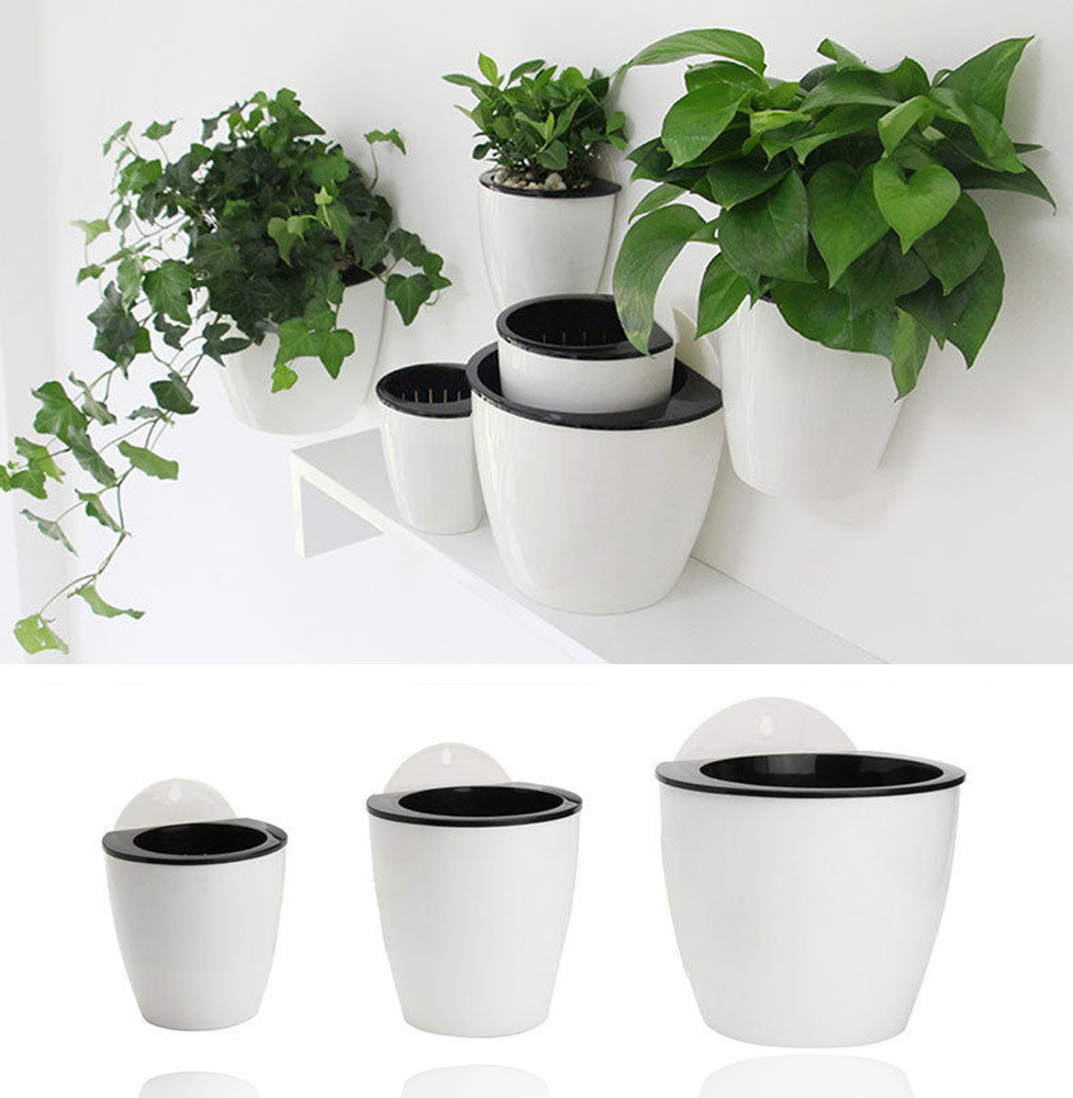 Self watering plant flower pot wall hanging plastic for Fence hanging flower pots
